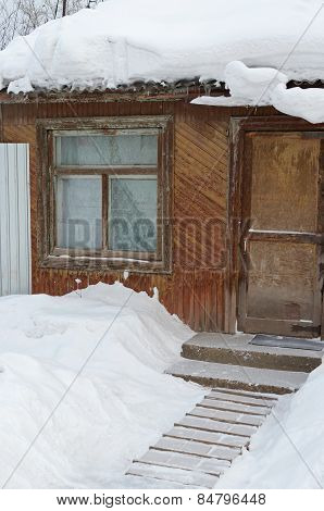 Snow-covered wooden house