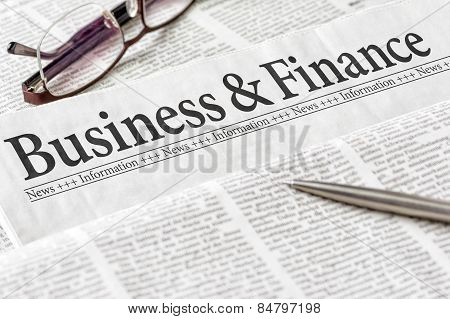 A Newspaper With The Headline Business And Finance