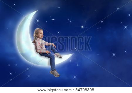 Little girl sits on the moon
