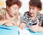 stock photo of receipt  - Two old women consider receipts - JPG