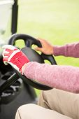 image of buggy  - Golfer driving his golf buggy forward at the golf course - JPG