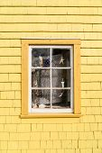 foto of quaint  - Quaint old window decorated in a nautical theme with fish net - JPG