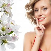 picture of  lips  - closeup portrait of attractive  caucasian smiling woman blond isolated on white studio shot lips toothy smile face hair head and shoulders looking at camera blue eyes tooth spring flowers - JPG