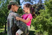 image of reunited  - Soldier reunited with her daughter on a sunny day - JPG