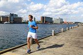 image of copenhagen  - Running man jogging in modern city - JPG