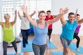 picture of senior class  - Happy fit men and women exercising in gym class - JPG