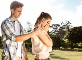 pic of argument  - Couple after an argument in the park on a sunny day - JPG