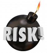 picture of dangerous  - Risk word in 3d letters on a black round bomb to warn you of potential danger or problems - JPG
