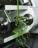 image of lube  - Close up of Green Floating Fluid in a machine - JPG