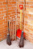 image of janitor  - simple janitor supplies on brick wall background - JPG