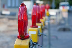 stock photo of truck-stop  - Cordon with warning lights at a roadwork construction site - JPG