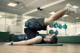 picture of pilates  - Fit man doing pilates in fitness studio against fitness interface - JPG