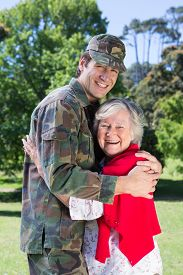 foto of reunited  - Soldier reunited with his mother on a sunny day - JPG