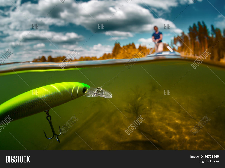 Split shot man fishing on pond image photo bigstock for Split shot fishing