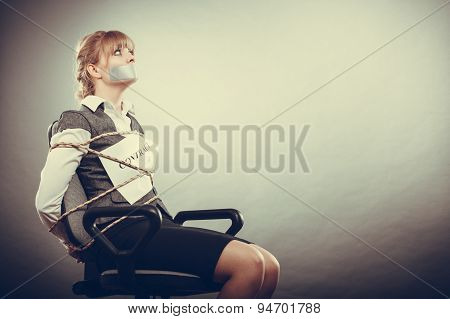 Businesswoman Bound By Contract With Taped Mouth.