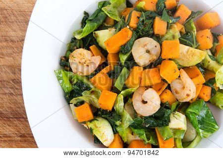 Sweet potato casserole with greens and shrimps