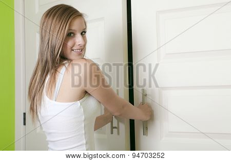 attractive teen girl open closet