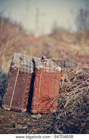 Two Old Vintage Suitcases Stand