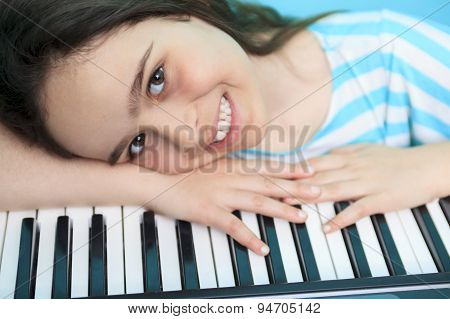 Young girl play digital  piano