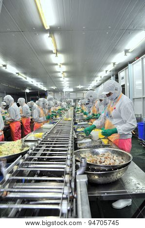Ho Chi Minh City, Vietnam - October 3, 2011: Workers Are Working Hard On A Production Line In A Sea