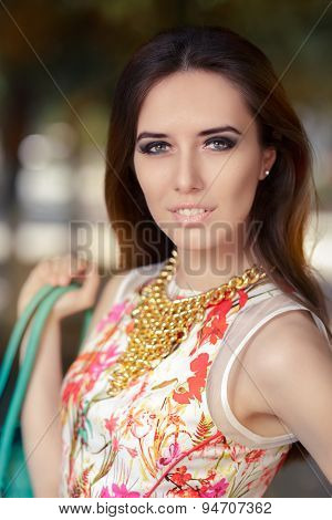 Stylish Woman Wearing Floral Dress, Necklace and Purse