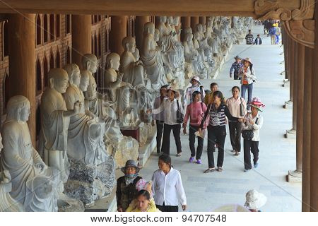 Ninh Binh, Vietnam - March 29, 2010: People Are Reaching To The Bai Dinh Pagoda, One Of The Largest