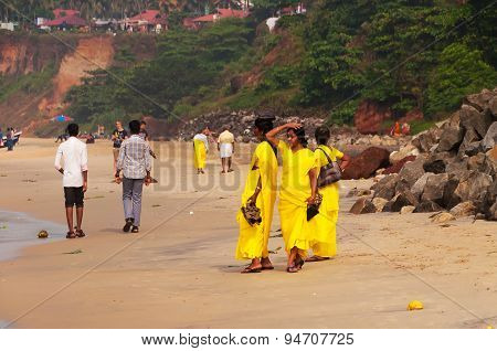 Pilgrims In Yellow Sari On The Papanasam Beach. Varkala