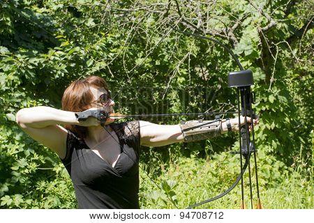 Woman Shoots A Bow