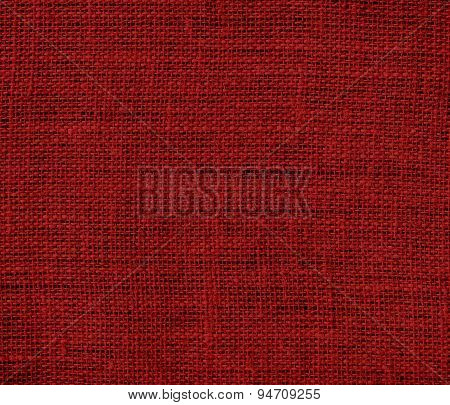 Deep maroon burlap texture background