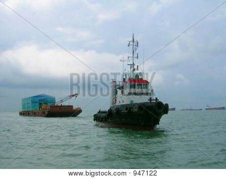Tug Boat And Barge In Open Sea