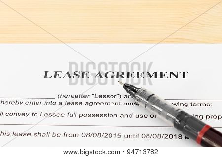 Lease Agreement Contract Document And Pen Horizontal View