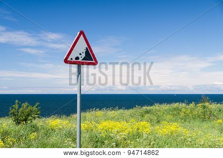 Precipice Edge Warning Sign. Danger Sea Cliff Hidden By Grass And Flowers