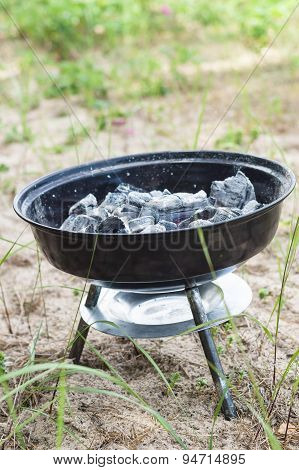 Small Grill With Smoldering Charcoal