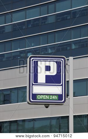 Parking Signpost With Open Text And Modern Building Background
