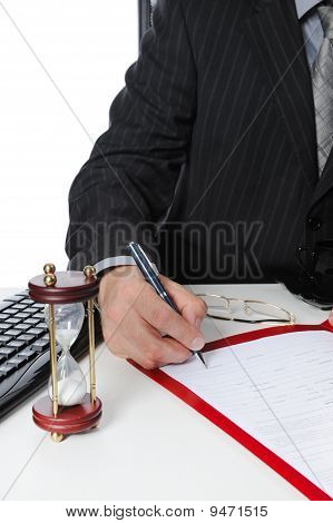 Man Signs A Document.