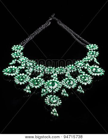 luxury green necklace on black stand