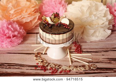 Wedding Cake Sorounded By Flowers