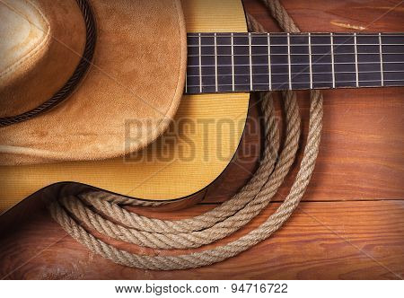 Country Music Picture With Guitar And Cowboy Hat And Rope