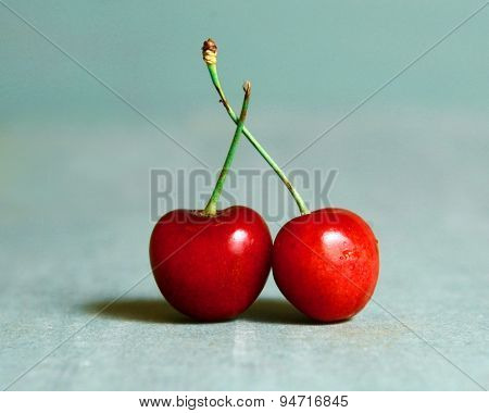 Two Sweet Cherry On The Blue Background