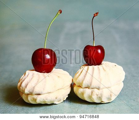 Sweet Cherry And Zefir On The Blue Table Background