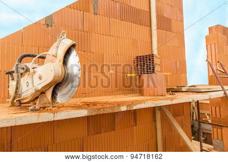 Brick By Brick,  Build A House On Your Own. Building A Home. Circular Saw For The Bricks.