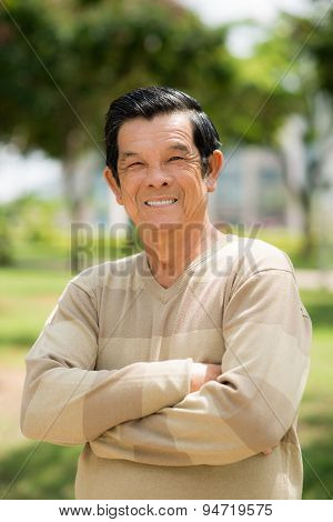 Optimistic Asian old man