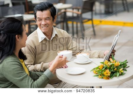 Senior married couple in a cafe