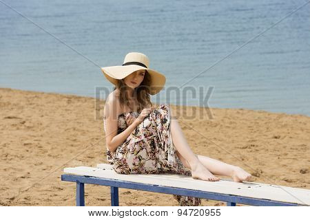 Summer Sweet Girl Sitting In Beach