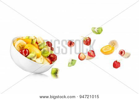 Fresh Mixed Fruit Salad Falling Into A Bowl Of Salad