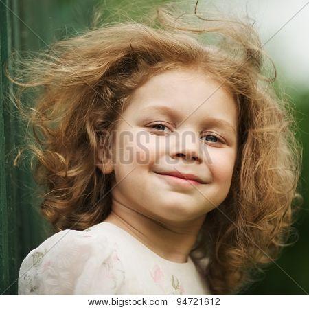 Happy Beautiful Cheerful Curly Little Girl