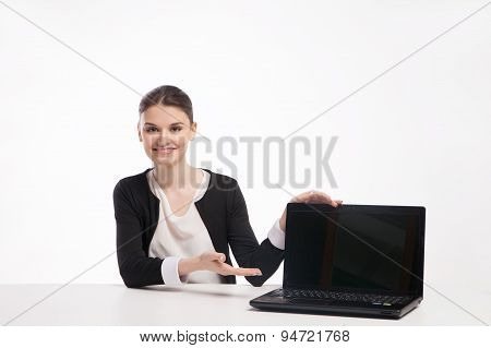 Young business woman presenting laptop