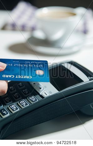 Woman Hand Using Payment Terminal In Restaurant