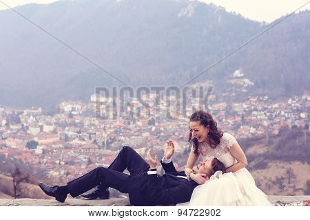 Bride And Groom With Many Houses On Background