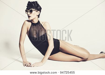 Girl Wearing Swimming Suit In The Studio